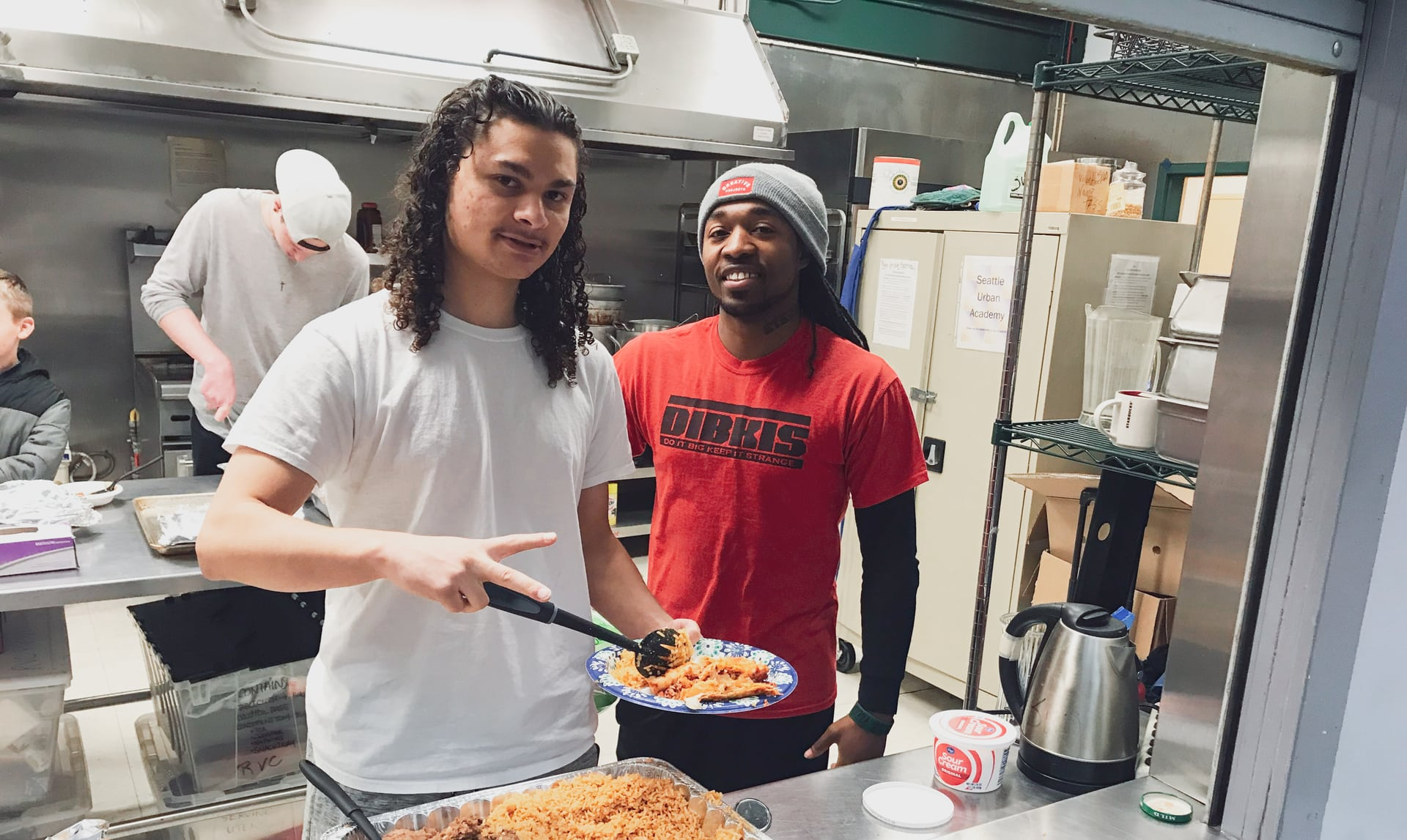 A photo of a student with a meal in South Seattle and Mike Davis